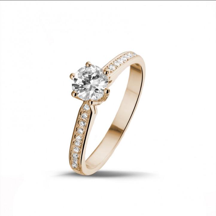 0.75 カラットのサイドダイヤモンド付きピンクゴールドソリテールダイヤモンドリング