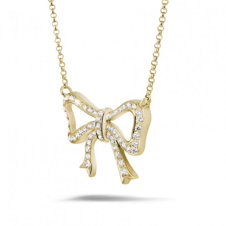 ダイヤモンドリボン付きイエローゴールドネックレス