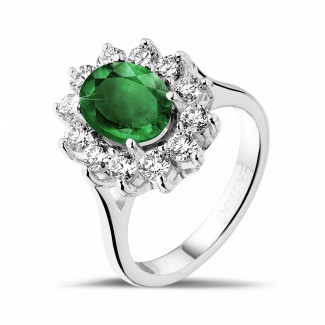 プラチナダイヤモンドエンゲージリング - オーバルエメラルドとラウンドダイヤモンド付きプラチナ取り巻きリング