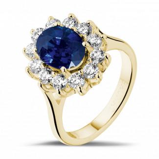 エンゲージリング - オーバルサファイアとラウンドダイヤモンド付きイエローゴールド取り巻きリング