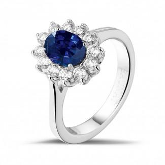 プラチナダイヤモンドエンゲージリング - オーバルサファイアとラウンドダイヤモンド付きプラチナ取り巻きリング