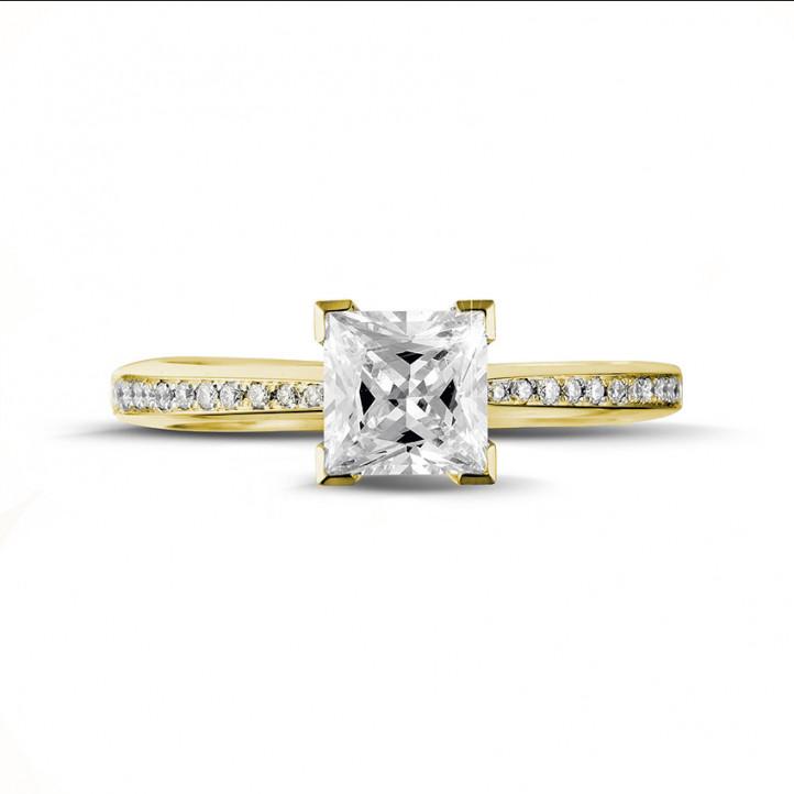 1.25 カラットのプリンセスダイヤモンドとサイドダイヤモンド付きイエローゴールドソリテールリング