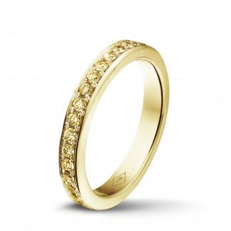 イエローゴールドダイヤモンドリング - 0.68 カラットのイエローダイヤモンド付きイエローゴールドエタニティリング(フルセット)