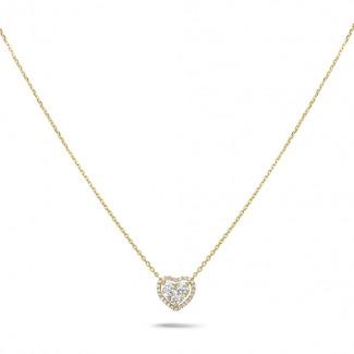 新商品 - 0.65カラットのラウンドダイヤモンド付きイエローゴールドハートシェイプのペンダント