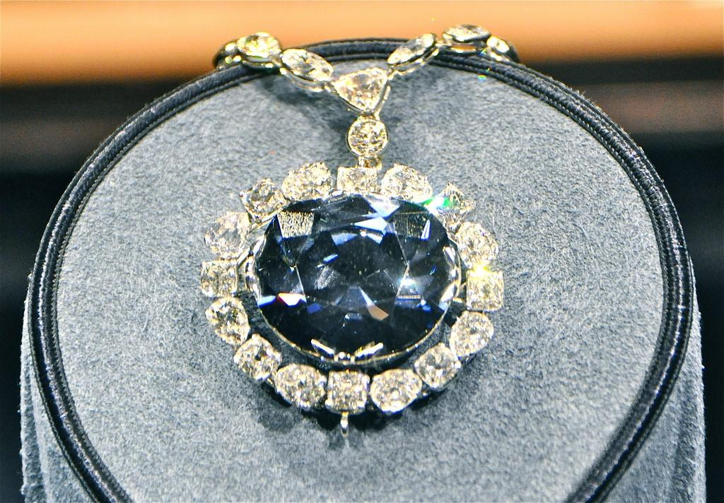 The Hope diamond surrounded by smaller diamonds in a necklace