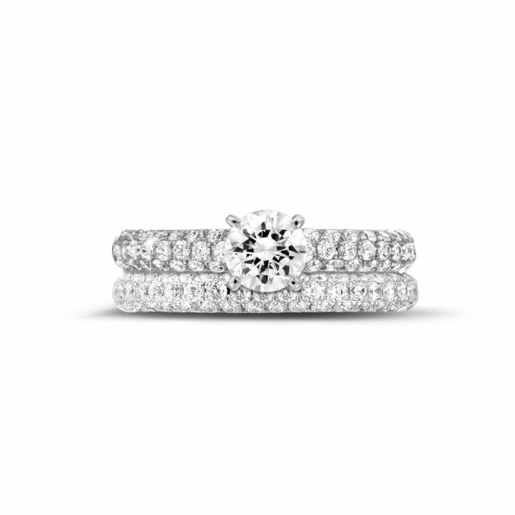 Set witgouden diamanten trouwring en verlovingsring met 0.70 caraat centrale diamant en kleine diamanten