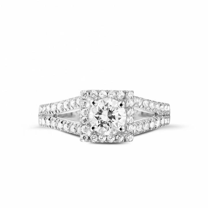 0.70 caraat diamanten solitaire ring in platina met zijdiamanten