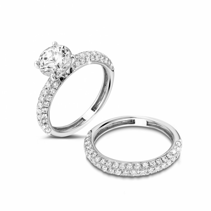 Set platina diamanten trouwring en verlovingsring met 1.50 caraat centrale diamant en kleine diamanten