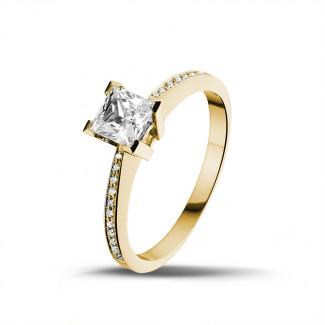 0.75 caraat solitaire ring in geel goud met princess diamant en zijdiamanten