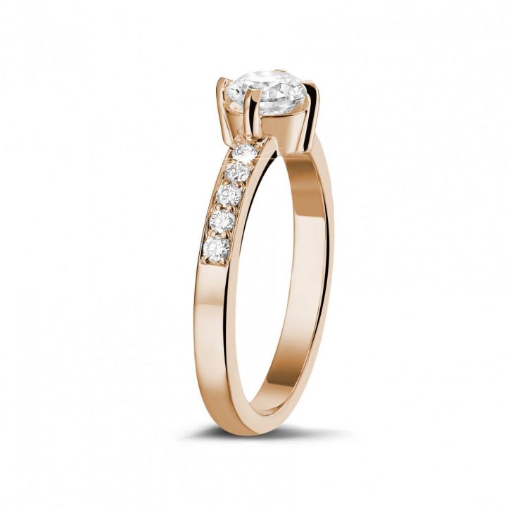 0.70 karaat diamanten solitaire ring in rood goud met zijdiamanten