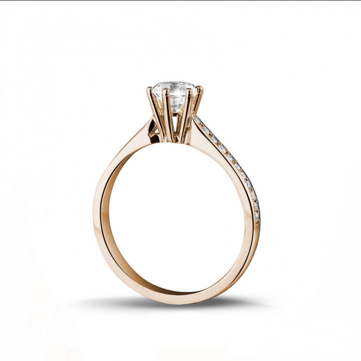 0.50 caraat diamanten solitaire ring in rood goud met zijdiamanten