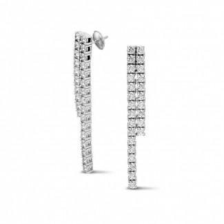 Oorbellen - 3.90 karaat diamanten rivière oorbellen in wit goud