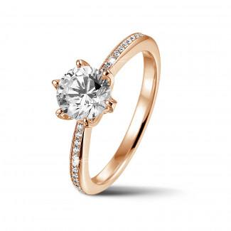 Ringen - BAUNAT Iconic 1.00 karaat solitaire ring in rood goud met zijdiamanten