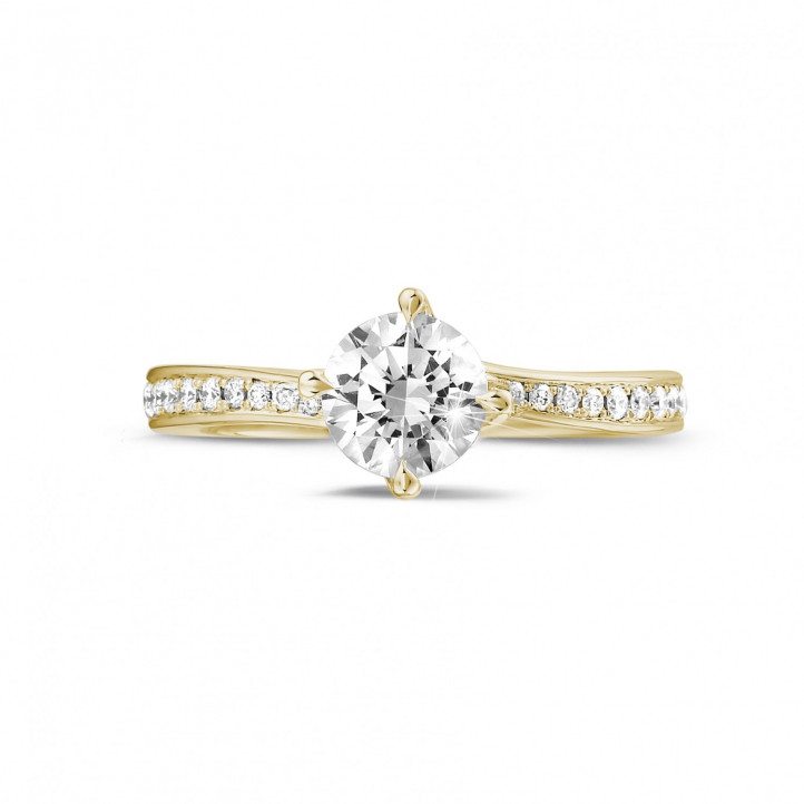 0.70 karaat diamanten solitaire ring in geel goud met zijdiamanten
