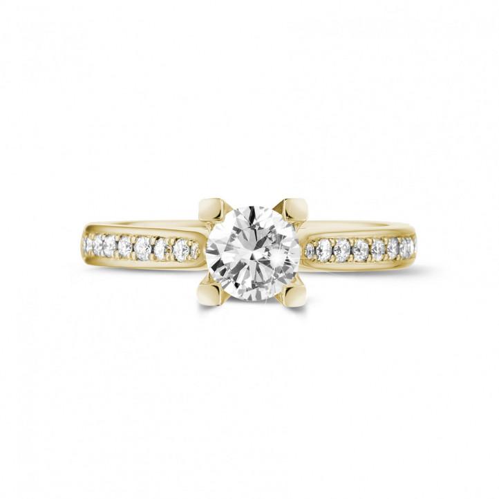 0.50 caraat diamanten solitaire ring in geel goud met zijdiamanten