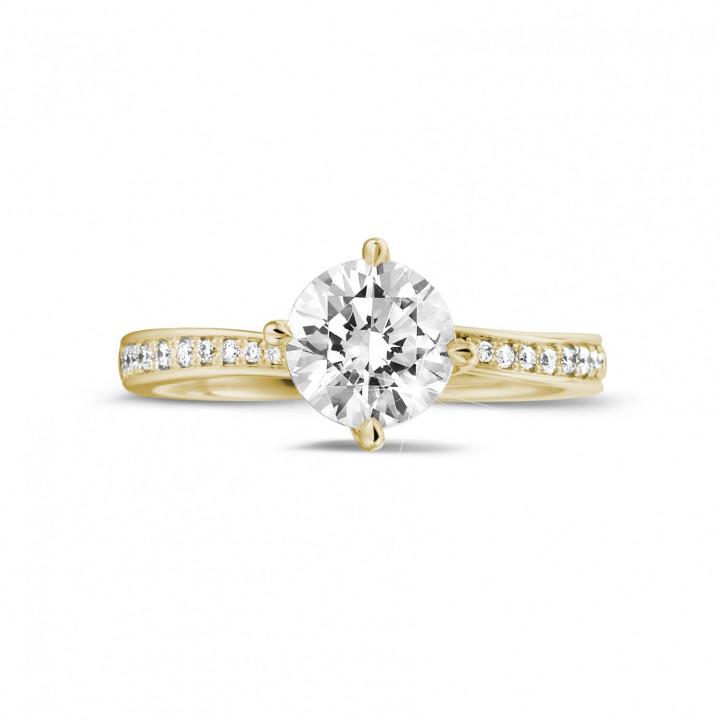 1.25 caraat diamanten solitaire ring in geel goud met zijdiamanten