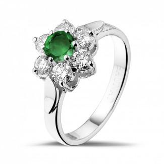 Juwelen met robijn, saffier en smaragd - Bloemenring in wit goud met ronde smaragd en zijdiamanten