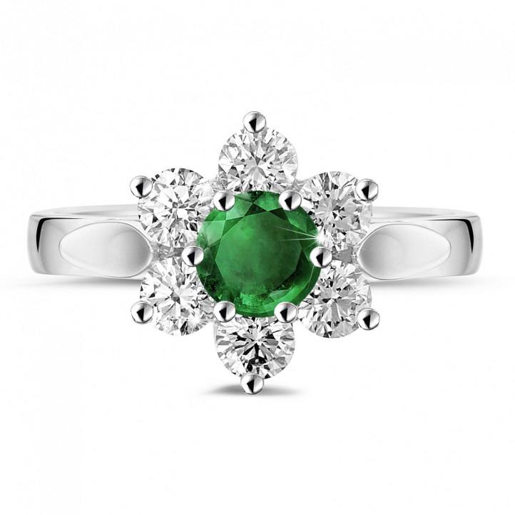 Bloemenring in platina met ronde smaragd en zijdiamanten