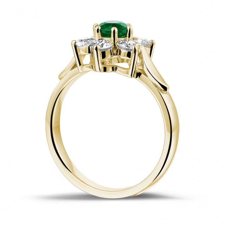 Bloemenring in geel goud met ronde smaragd en zijdiamanten