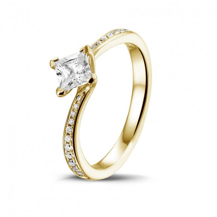 0.50 karaat solitaire ring in geel goud met princess diamant en zijdiamanten