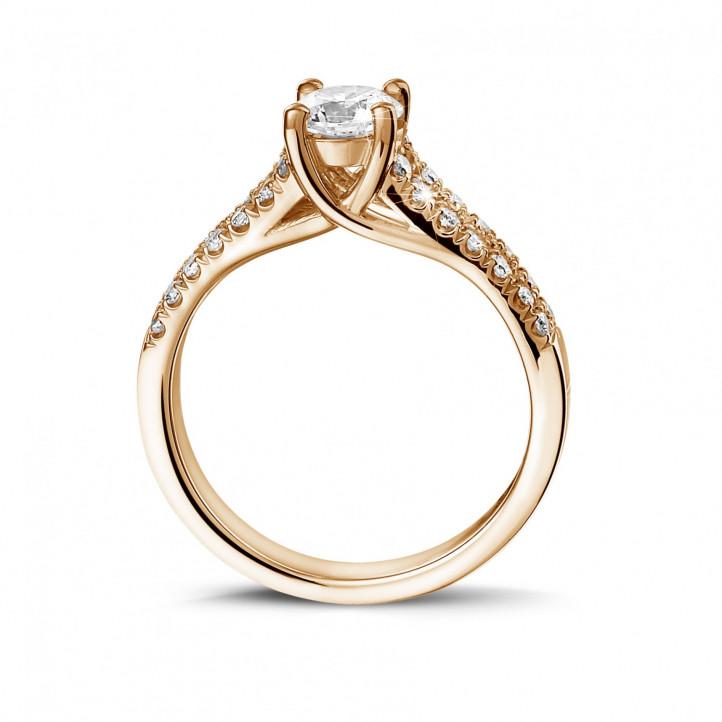 0.50 karaat solitaire ring in rood goud met zijdiamanten