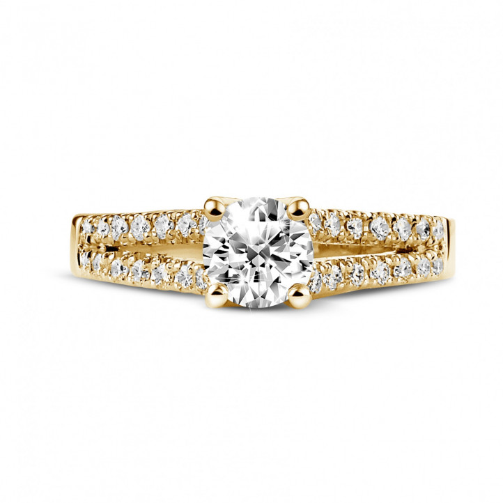 0.70 karaat solitaire ring in geel goud met zijdiamanten