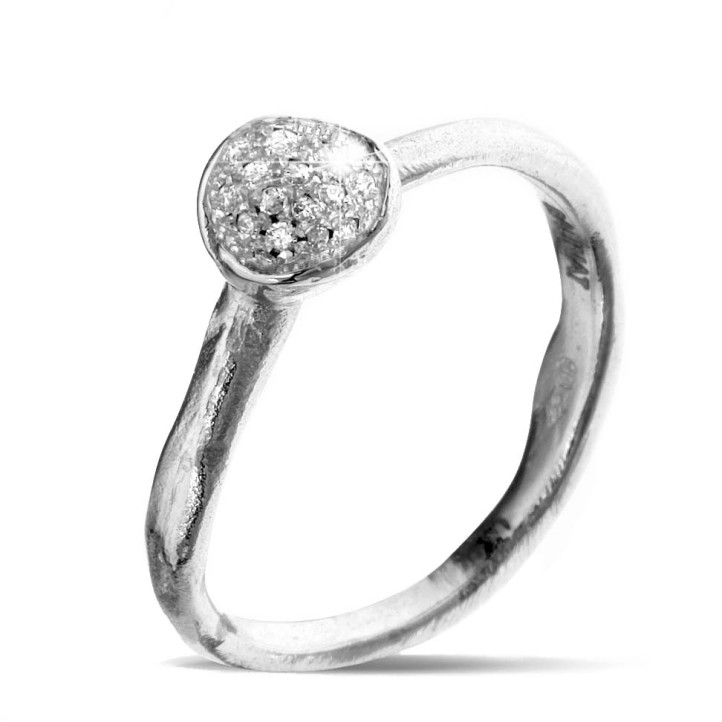 0.12 caraat diamanten design ring in platina