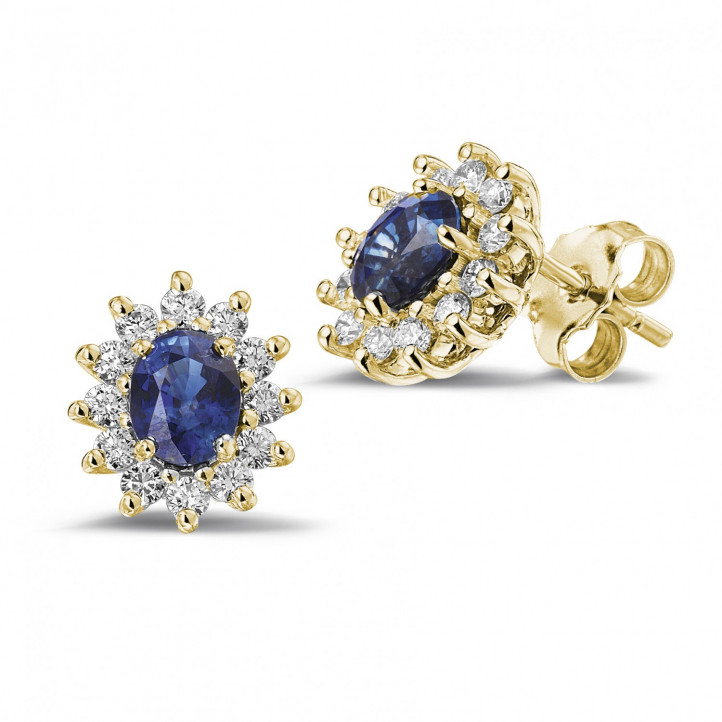 Entourage oorbellen in geel goud met ovale saffier en ronde diamanten