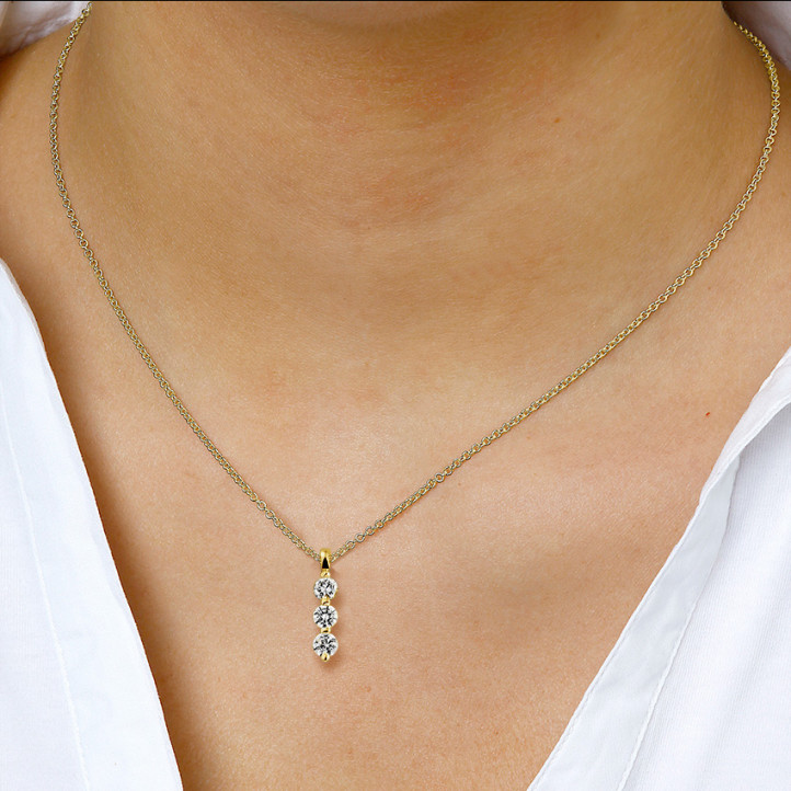 0.75 karaat trilogie diamanten hanger in geel goud