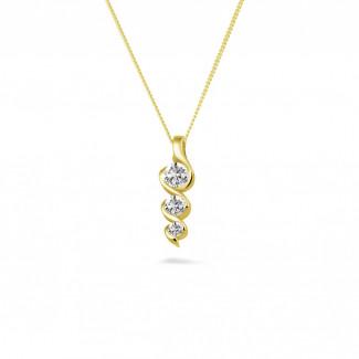 0.38 caraat trilogie diamanten hanger in geel goud