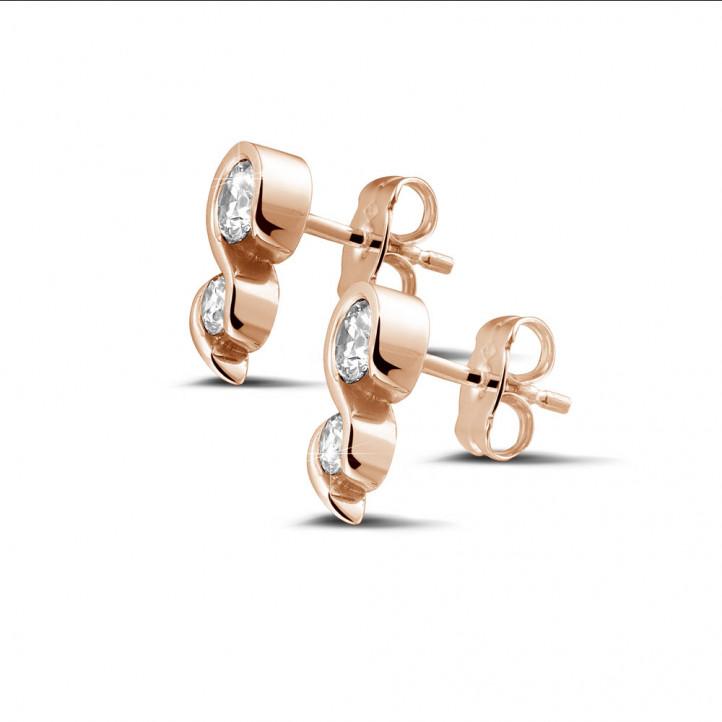 0.70 karaat diamanten oorbellen in rood goud