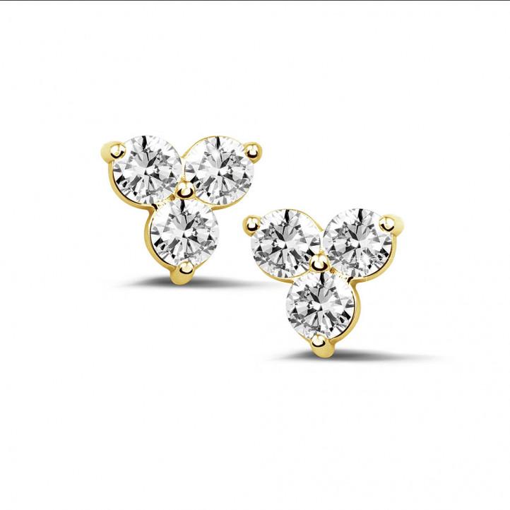 1.20 karaat diamanten trilogie oorbellen in geel goud
