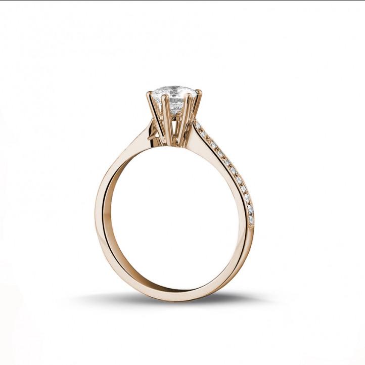 0.75 karaat diamanten solitaire ring in rood goud met zijdiamanten