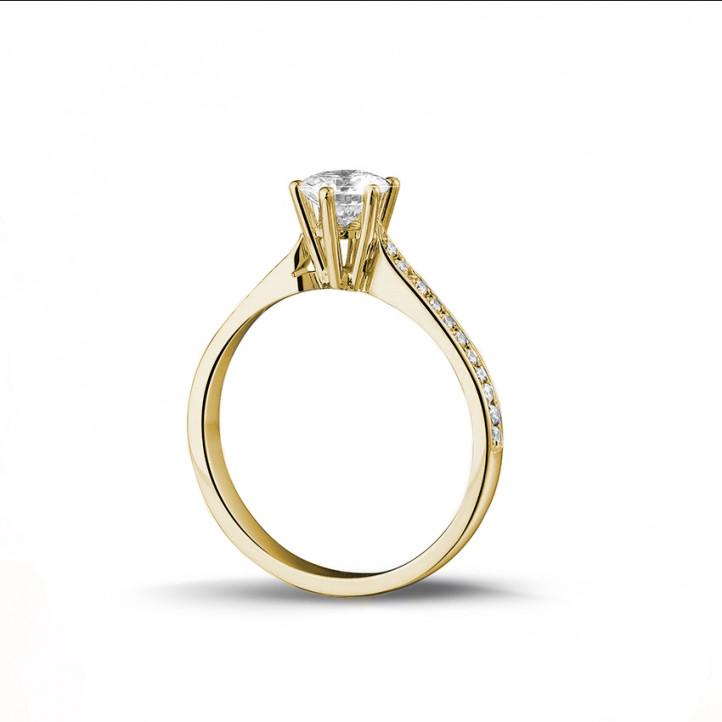 0.75 caraat diamanten solitaire ring in geel goud met zijdiamanten