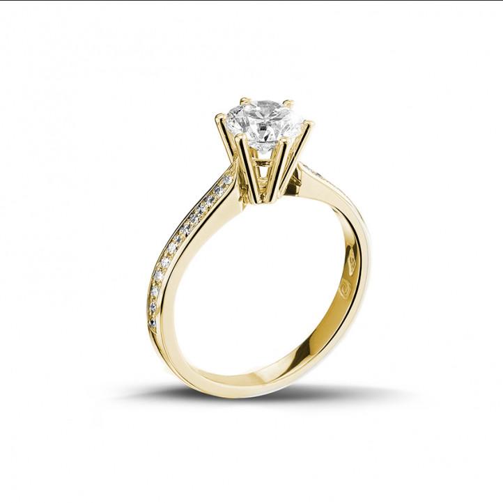 0.90 karaat diamanten solitaire ring in geel goud met zijdiamanten