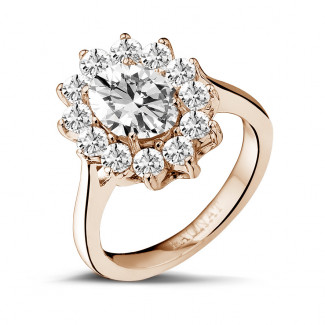 2.84 caraat entourage ring in rood goud met ovale diamant