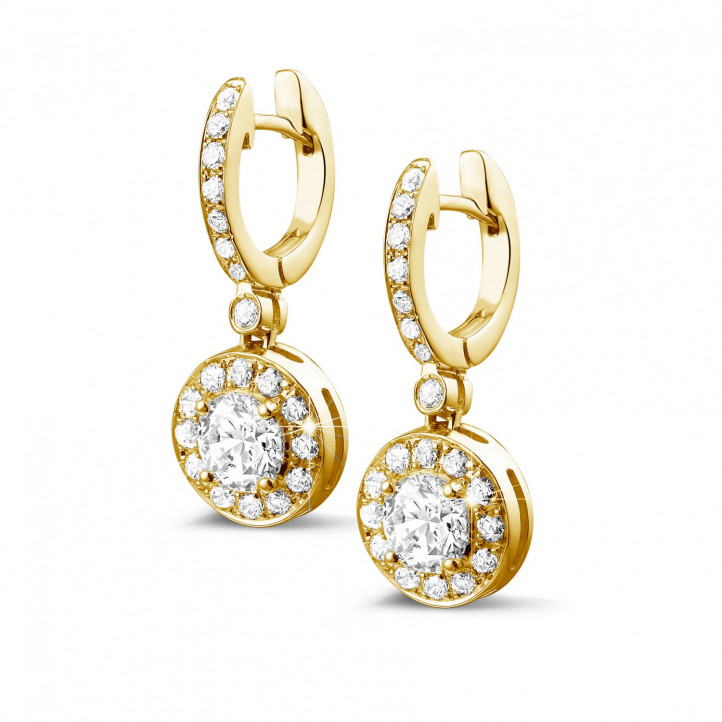 1.55 caraat diamanten halo oorbellen in geel goud