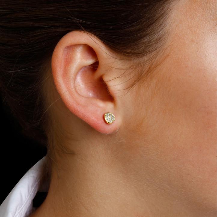 0.25 caraat diamanten design oorbellen in geel goud