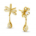 0.95 karaat diamanten bloem & libelle oorbellen in geel goud