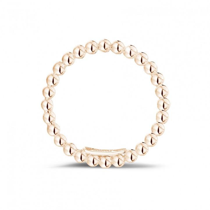 Combinatie ring met bolletjes in rood goud