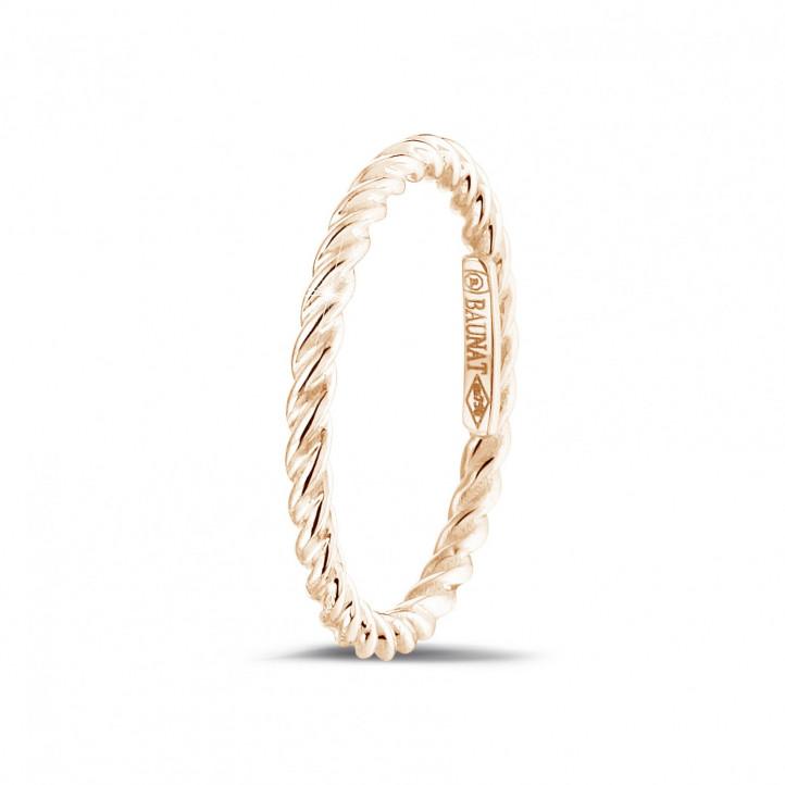 Gedraaide combinatie ring in rood goud