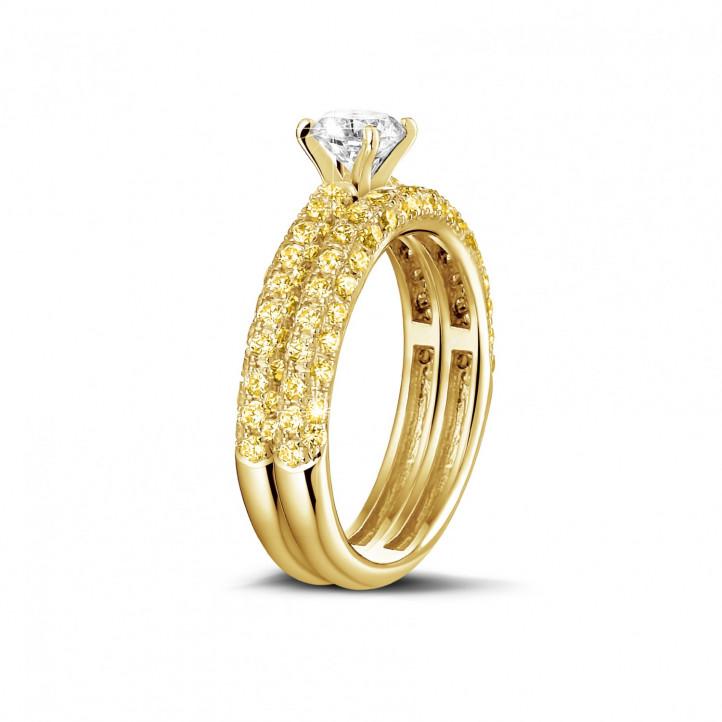 Set geelgouden diamanten trouwring en verlovingsring met 0.50 karaat centrale diamant en gele zijdiamanten