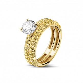 Set geelgouden diamanten trouwring en verlovingsring met 1.00 caraat centrale diamant en gele zijdiamanten