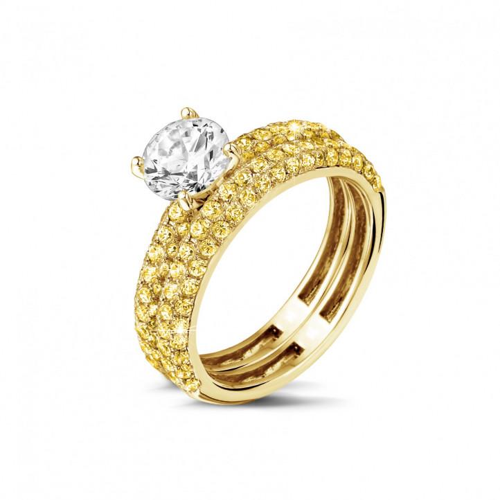 Set geelgouden diamanten trouwring en verlovingsring met 1.20 karaat centrale diamant en gele zijdiamanten