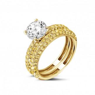 Set geelgouden diamanten trouwring en verlovingsring met 1.50 caraat centrale diamant en gele zijdiamanten