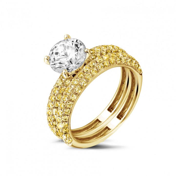 Set geelgouden diamanten trouwring en verlovingsring met 1.50 karaat centrale diamant en gele zijdiamanten