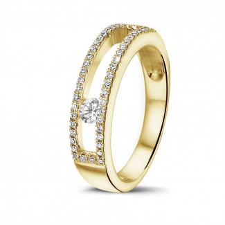 0.25 caraat ring in geel goud met zwevende ronde diamant