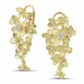 0.70 karaat diamanten design bloemenoorbellen in geel goud