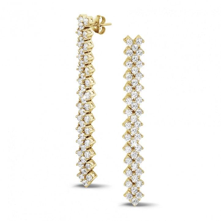 5.80 karaat diamanten oorbellen in geel goud met visgraat design