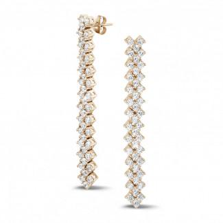Exclusieve juwelen - 5.80 karaat diamanten oorbellen in rood goud met visgraat design